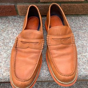 Men's brown and orange two toned loafers.